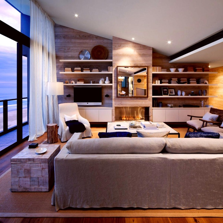 gorgeous modern beach house themed living room. love the floating shelves. modern built in idea, with the lower cabinets floating as well
