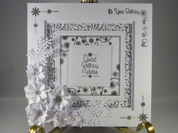 8x8 card made using the daisy stamps in white and silver