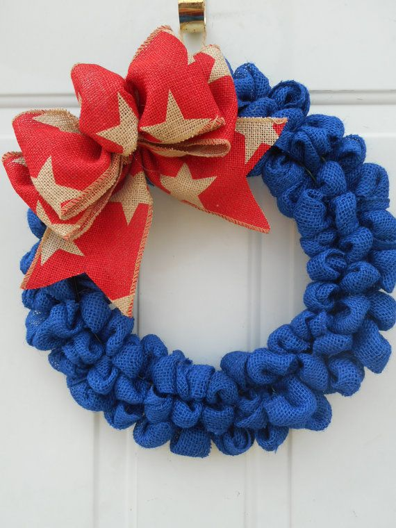 This is a handcrafted one of a kind wreath that Ive created using a 14 wire wreath form and generously looping a pretty royal blue burlap