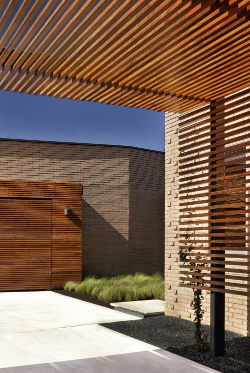 Ipe wood trellis and garage door...great idea to create a modern pergola for a rooftop deck