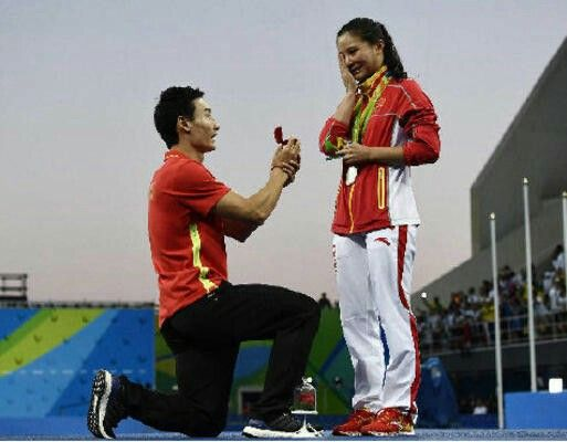 Love in Rio  	   Medal, and a ring: Chinese diver Qin Kai proposes to silver medallist He Zi at the podium ceremony of the women's diving 3m springboard final at the Rio 2016 Olympic Games at the Maria Lenk Aquatics Stadium in Rio de Janeiro on Sunday. Qin won a bronze medal in the men's synchronized 3m springboard. — PHOTO: AFP (REPORT ON PAGE 17)