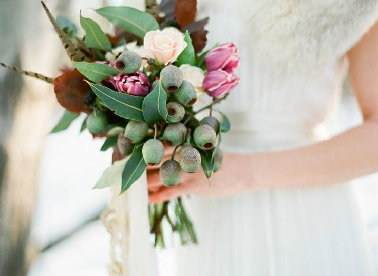 Gumnuts, eucalyptus, tulips and feathers. Australian Native flowers mix well in any kind of bouquet