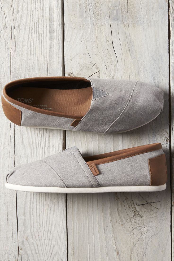 Frost Grey Chambray Men's TOMS Classics for comfort and style. These slip-on shoes have a molded footbed for extra cushioning and are made from grey chambray denim.