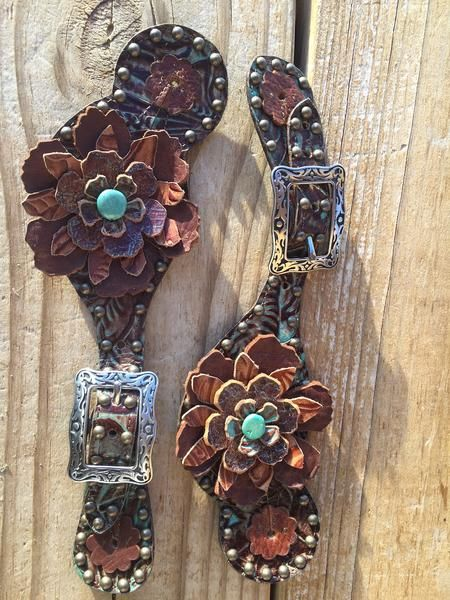 Beautiful spur straps with flowers . Hand made by The Rowdy Cowgirl. Turquoise and brown with silver buckle