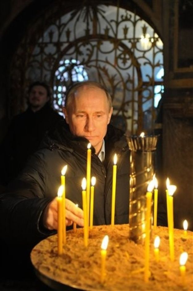 He lights candles sometimes. | 32 Pictures That Prove Vladimir Putin Is Only Human
