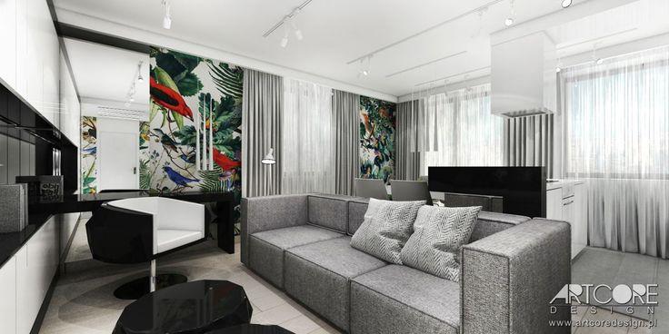 Luksusowy apartament - czarno białe wnętrze z kolorowymi grafikami. Więcej na www.artcoredesign.pl .