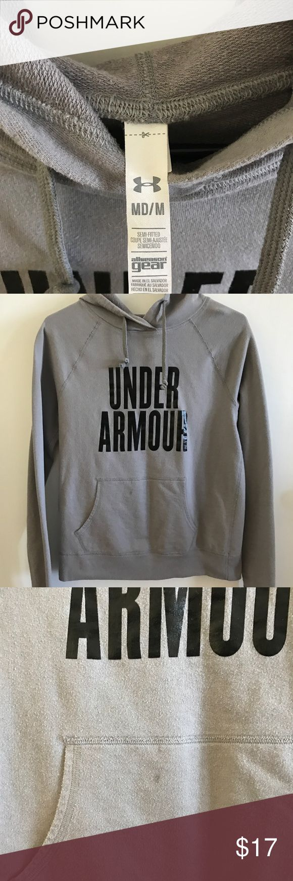 Under armour grey hooded sweatshirt sweater Good condition, however has a stain in front and on sleeve.  Please see picture! Under Armour Sweaters