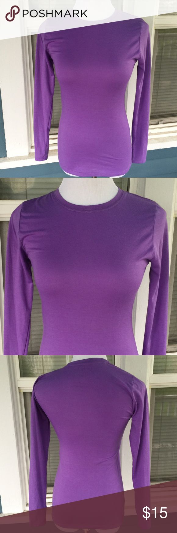 "SCRUBS & BEYOND Long Sleeve Undershirt Tee SCRUBS & BEYOND Purple Long Sleeve Undershirt Tee.   Long sleeves.   Crew neckline.  Light purple cotton/spandex blend material.  Shoulder width 13"""".  Pit-to-pit 16"" (unstretched).   Length 26"" (shoulder to hem).  Great condition. Scrubs & Beyond Tops Tees - Long Sleeve"