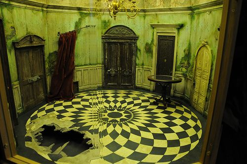 Abandoned does this not remind you of Alice in wonder land with the glass circle table and the small door behind the curtain.....