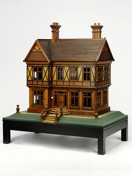 One of Queen Mary's doll houses. Made in 1887 for a Miss Barker and bought by Queen Mary from the Royal School of Needlework