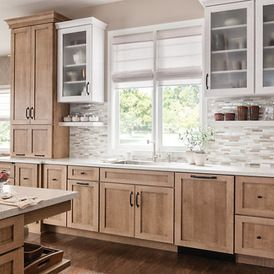 by Schuler Cabinetry.  like the brown stain. I might put a touch of gray in it to make it perfect,