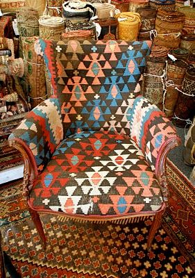 chair upholstered in a stunning Turkish kilim rug