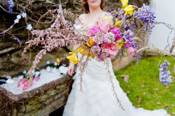 Wisteria and spring flower hand bouquet Co-ordination & concept: Creation Events Flowers: Paradiso Flowers Photography: Cheryl McEwan Cake & sweets: Jukie D Stationery: Invitation Cafe Laser cut garland and table number: Doodles Hair & makeup: Powder Puff Dresses: Brides of Somerset Venue: Hathersage