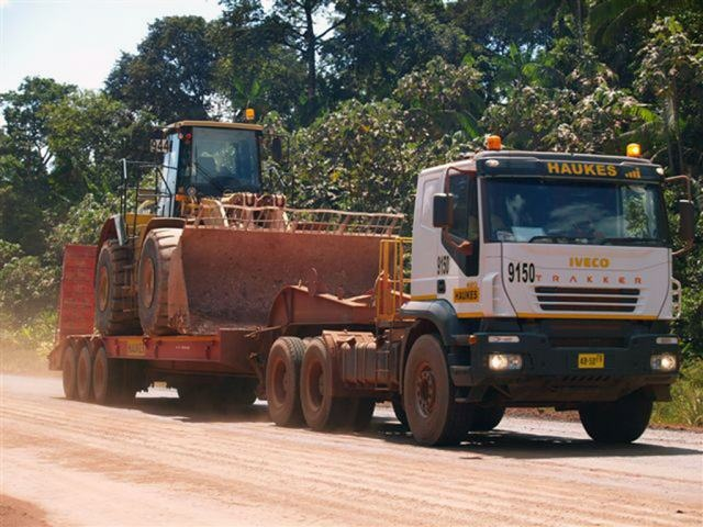 Iveco tractor and Lodico flat bed at work for Haukes in Suriname