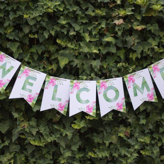FREE printable: Welcome guests to a garden fete with this floral bunting. Every letter of the alphabet is included so you can pick wording.