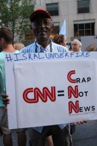 Stephen Tebid, a retired journalist, holds a sign saying 'CNN=Crap Not News' at protest in New York on August 8, 2014. (Cathryn J. Prince/Th...  U