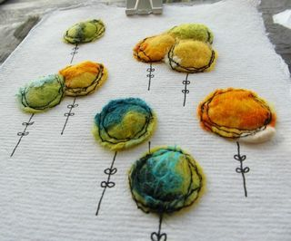 Little felty springy flowers! Annie I love making handmade felt pictures, sometimes leaving them just...