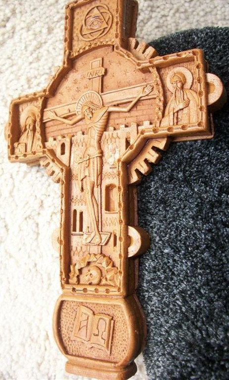 This is a Romanian Orthodox cross composed of wax and incense. It is meant to represent that Romania, being a religious country to a large extent, features many religious rituals. Nowadays, these rituals are not so predominant in urban areas, but they are still considered highly important in rural areas.