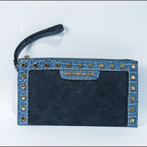 "Michael Kors Selma Pick Stitch Large Zip Clutch Brand new. Authentic. Made of denim canvas with embossed leather trim, logo and studded detail on front & back. Top zip closure. Interior features 6 credit card slots and one slip pocket. 7"" wrist strap drop. Michael Kors Bags Clutches & Wristlets"