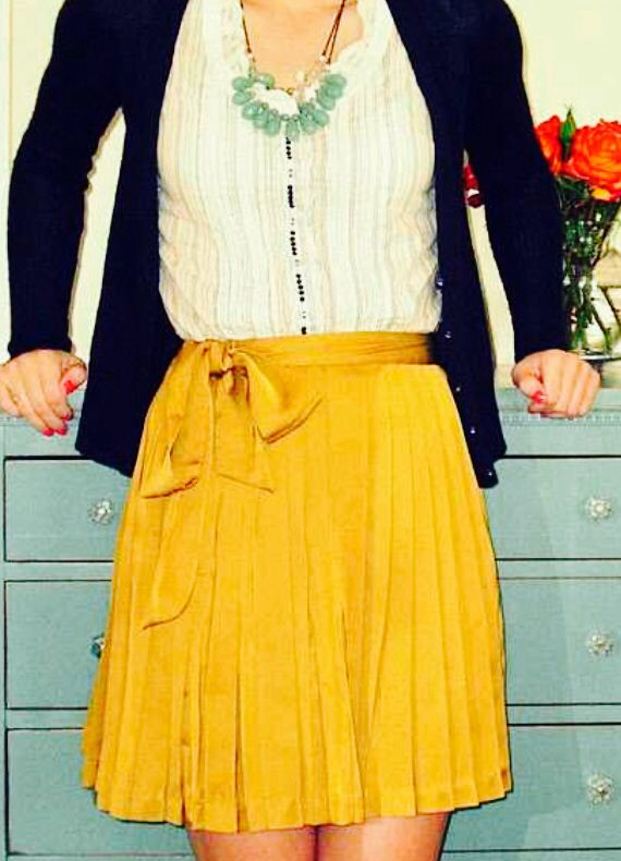 Navy blue cardigan | white blouse with mint necklace | mustard yellow skirt