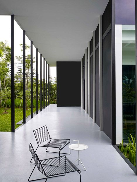 Traditional black and white colonial houses influenced the monochrome palette of this private gallery and showroom in Singapore.