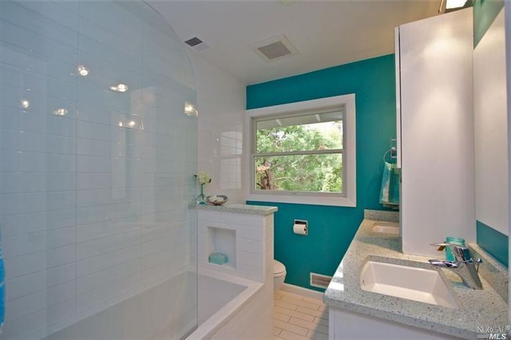 Turquoise accent wall in the bathroom