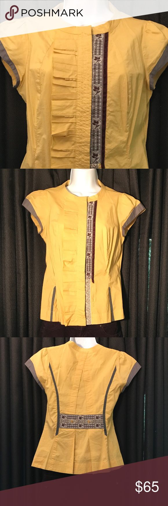 Unique Asian fusion inspired blouse Anthropology/Floreat cap sleeved button down blouse with beautiful detail. 100% Cotton in a lovely yellow ochre with silk and velvet details, carved buttons. Great attention to detail on this piece, front and back. Paired with a pencil grey skirt for a smart biz look as easily with your favorite jeans. floreat Tops Button Down Shirts