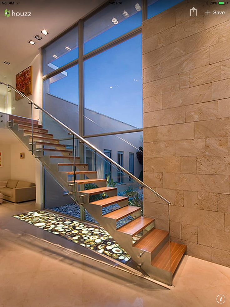Modern wood staircase with glass support railing
