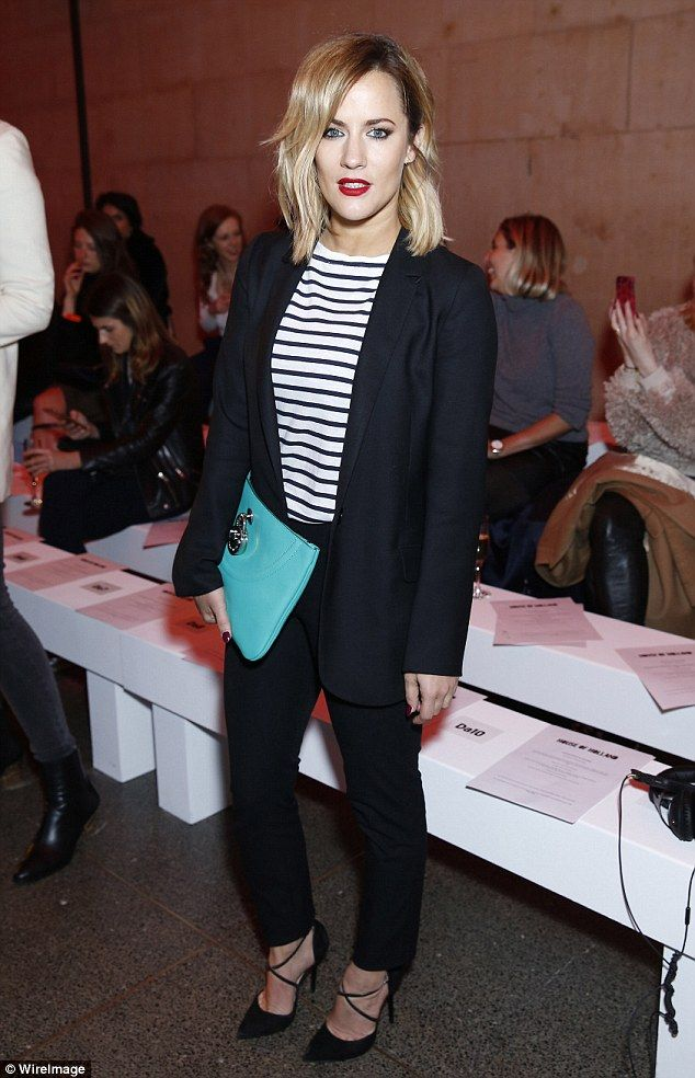 In need of a party: Caroline Flack joined some of her closest pals for the star-studded House of Holland show at London Fashion Week on Saturday