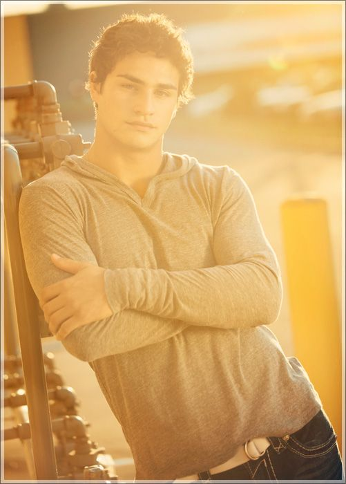 Folded arms is very masculine for guys pictures and the half-smile is attractive for senior girls!