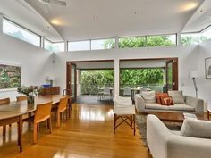 Photo of a white living room idea with floorboards & bi-fold doors from the realestate.com.au Home Ideas Living Room image galleries - Living Area photo 1531712. Browse hundreds of images of white living areas & photos of bi-fold doors in living room designs.