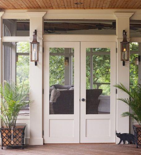 exterior | screen doors. Love the lantern sconces.Columns flanking double screen doors