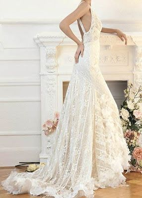 Such a prett dress. I seriously wish I were a wedding dress model. I could play dress up all.day.long. =D