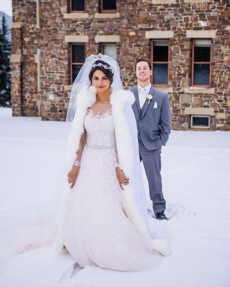 This first look photo . Photo: Brad Heninger Photography || Planning/Design: @lynnfletchercsep of @lynnfletcherweddings || Venue: @rimrock_resort #lynnfletcherweddings #lfwloves #firstlook #winterwedding #banffwedding #destinationwedding