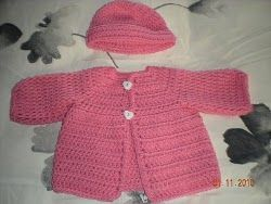This free crochet pattern is adorable for your baby girl. The heart buttons are the perfect little embellishment and the pink color is great for any time of year. It's nice and soft to keep her warm.