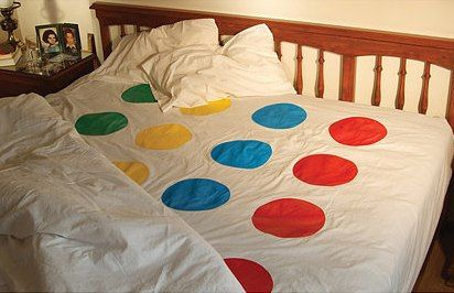 wedding gift idea :) maybe given at the lingerie shower??  Traditional Twister mats are too slippery, paint these on a flat sheet-problem solved