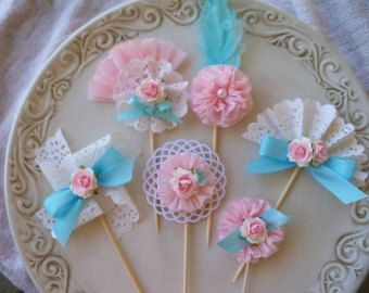 The bodice is pale pink with a four layer crepe paper ruffle. A pink mulberry rose adorns one shoulder.    Celebrate your ballerinas recital or birthday party with these adorable paper cupcake toppers. Place them on cupcakes or a frosted cake for an awesome centerpiece.    Purchase the matching princess crown, invitations or decorative wand as shown in the last photos to go with the toppers.    Set of SIX