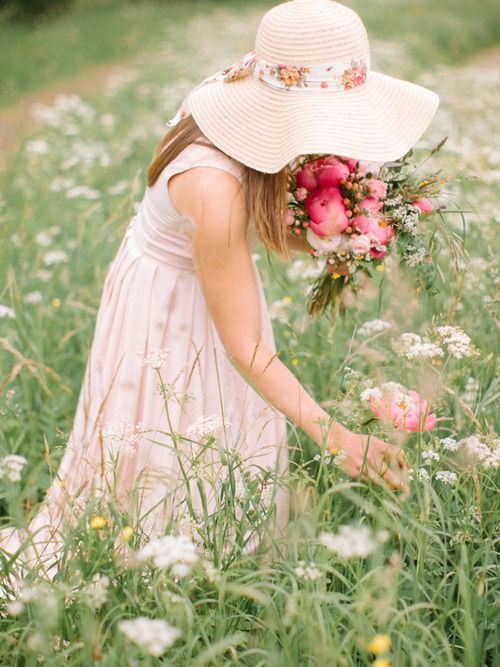 Posing as if you're really finding and picking those big, pink blooms in that…