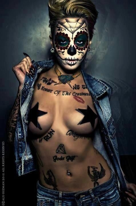 inked girl with day of the dead make up