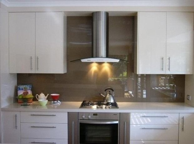 Buying Guide: Kitchen Back splashes; I'm interested in solid glass or plexiglass back splashes.