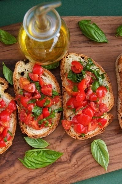 There are few things I like better than good olive oil, crusty bread and fresh tomatoes in the summer. Mmm bruschetta :)