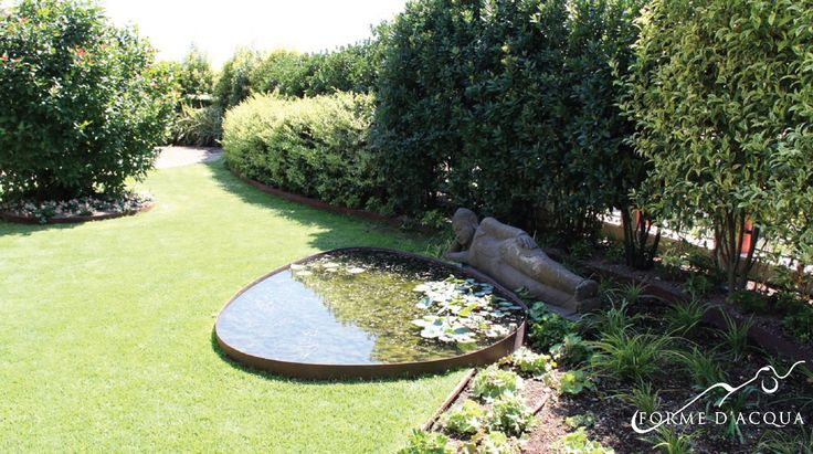 Private penthouse, Garden terrace Landscape/ arch. Simona M. Favrin / Japanese cherry tree, a Cornus florida, a Carolina sweetshrub and a Japanese allspice; pool of water filled with dwarf water lilies and other tall aquatic plants