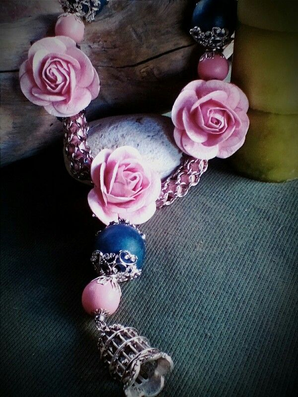 Made by Ella Blue. Paper roses (mod podged and varnished), caged glass beads and wooden beads