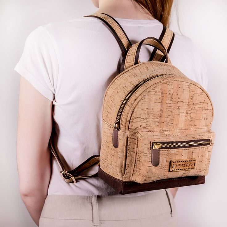 Mini Backpack of Natural and Brown Cork Handcrafted Solid Olive Wood logo Adjustable shoulder straps Water resistant 100% natural cork Lined interior