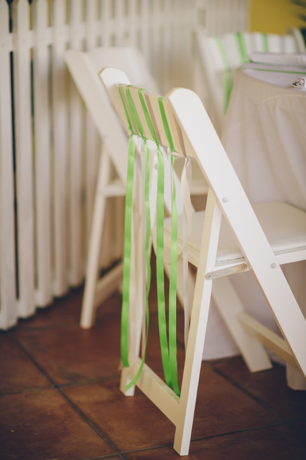 Green ribbon chair decor at award winning