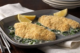 Lemon Tilapia Florentine 10  RITZ Reduced Fat Crackers, crushed (about 1/2 cup) 4  tilapia fillets (1 lb.) 1 tub  (10 oz.) PHILADELPHIA Savory Lemon & Herb Cooking Creme, divided 2 Tbsp.  milk 1 pkg.  (6 oz.) baby spinach leaves