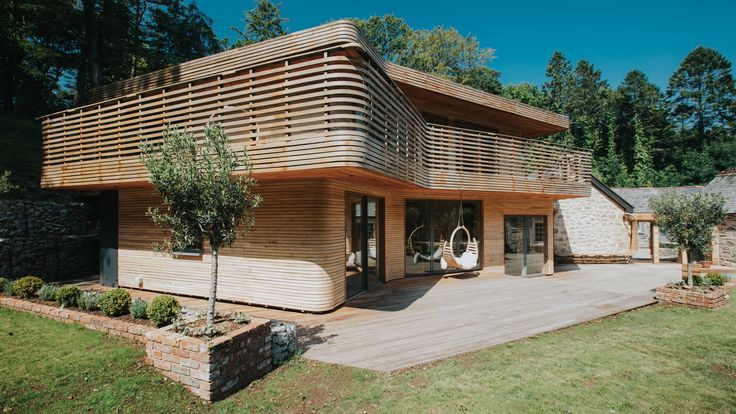 Furniture designers Tom and Danielle Raffield have used steam-bent timber to cover this extension to an old gamekeeper's lodge in Cornish woodland, which featured in UK television show Grand Designs earlier this month.