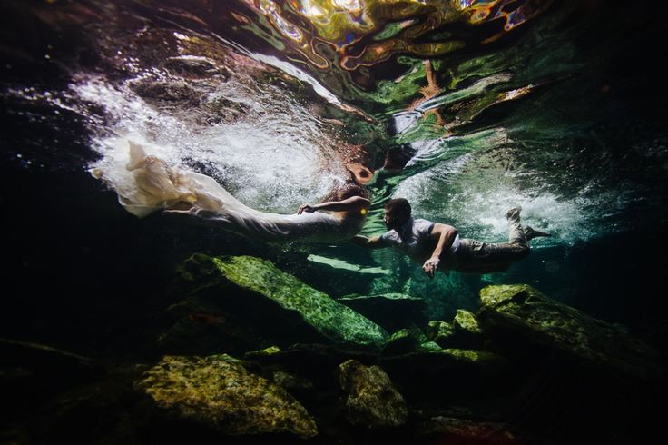 """Took a little persuading with this bride when it came down to doing a trash the dress in her """"actual"""" wedding dress in the cenote's in the Riviera Maya, Mexico.  After much reassurance her dress would be fine 😁 she did it! Absolutely gorgeous shot here."""