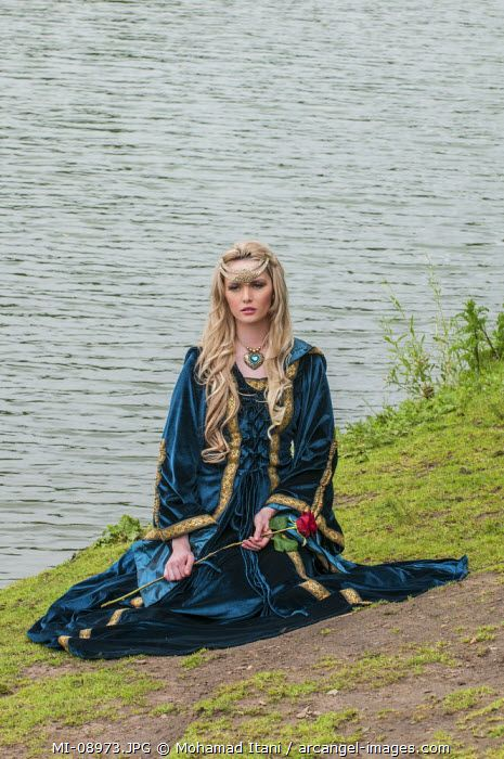 www.arcangel.com - renaissance-woman-sat-by-the-river-holding-a-red