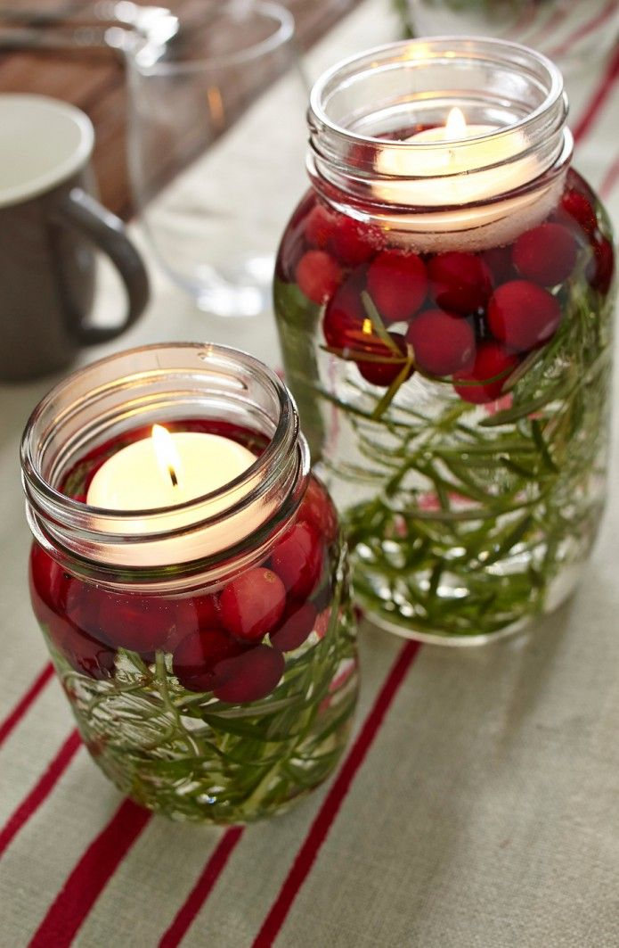 Table decoration. Rosemary and cranberries... perfect centerpieces for winter weddings!